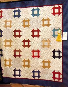 Churn Dash quilt spotted at a quilt show, posted at WonkyGirls Journal.  Made in Old Glory Gatherings fabrics.