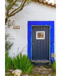"It's Two Door Tuesday again. First one a beautiful blue rim on a dark blue door. - GPS 3924'42"" N 913'20"" W #Doors #Portas #Photography #Art #Textures #Portugal #Series #Canon #loveofdoors #doorsagram #Beautiful #lovely #outdoors #instalike #instagood #love #follow #followme #lightroom #instafollow #like4like #photooftheday #ihavethisthingwithdoors #world_doorsandwindows #chasing_facades #me #cute #smile #shy"