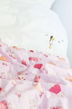 Pretty bed linen for the girls, via Down That Little Lane.