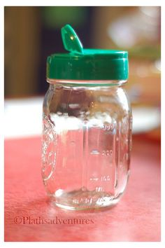 A lid from parmesan cheese fits on a mason jar. amazing. this website has a crazy awesome list of stuff like this.