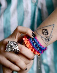Fury Wolf Silver Ring + colourful bangles + awesome tattoo = <3