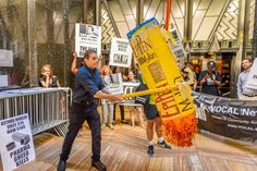 A giant EpiPen piñata filled with gold coins was smashed to visualize the greed…