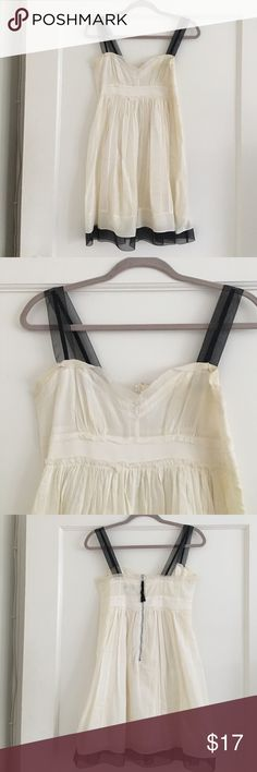 Ann Taylor Loft Sundress with detailing Off white Sundress with cute feminine detailing. Dress length comes to mid thigh. Cotton lining under dress. Light stain within folds of the dress. Shown in picture LOFT Dresses