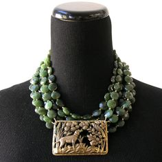 "Cheerful Conversation necklace by Emily Wheat Maynard, on Elva Fields. Antique brooch, faceted ""jade"" beads, copper clasp."