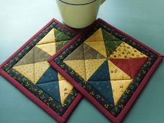 Quilted Pot Holders /Set of two pot holders, Patchwork with fabric in burgundy, green,beige and blue by RubysQuiltShop on Etsy