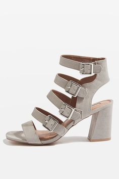 Party-sandals are a must-have for spring/summer. This pair comes in grey with multi-buckle detail and a mid-heel.