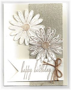 The card - more daisies.  I stamped one set full strength and the other one I stamped off to make it a bit lighter.  The strip on the si...