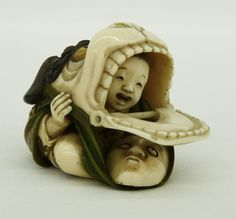Fine Netsuke of Child Hiding in Foo Lion (Dog) Theater Noh Mask  with Moveable Mouth Piece - Japanese Carved & Colored Ivory with Inlaid Cinnabar & Mother of Pearl Accents