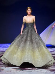 We first shared Michael Cinco's magnificent Fall/Winter 2017 couture collection inspired by Château de Versailles, the palace built during the reign of Louis XIV – the Roi Soleil (Sun King), earlier this year. It received such a strong response that the moment we found out new images had been released, we absolutely had to share them with you and light your whole day. Shine on!