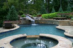 An Astonishing Pool with Stone Coping, Waterfall feature is lovely. Woodstock, GA  Walking on Sunshine :-)