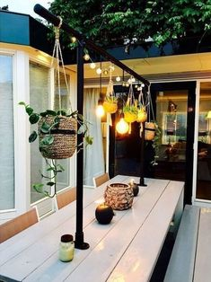 I love the idea of hanging plants and lights above an outdoor dining table to create a feature! - Home Decoration Patio Yard Ideas, Backyard Landscaping, Patio Table, Backyard Ideas, Dining Table, Garden Ideas On A Budget, Backyard Covered Patios, Budget Patio, Kitchen Plants