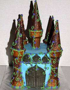 Castle cake    Uses two types of ice-cream cones as towers.  Nice vines.