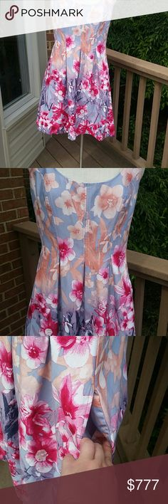 "Blue and pink floral Nine West dress with pockets! Beautiful light blue dress adorned with pink, peach, lavender,  and white flowers. A line, scoop neck, back zipper and pockets!!! (See photo 3) Darted detail gives the waist an ultra slimming look. measurements laying flat : bust 18.5"" waist 16"" hips 25"" length from top of strap to hem: 37"". Bust is lined. 98% cotton 2% elastane. Excellent condition.  Wore to a wedding shower 1x. Reasonable offers welcome and accepted. :) Nine West Dresses…"