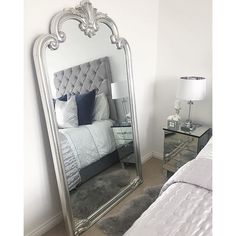 "Ornate full length mirror with hand finished silver scroll design frame. A beautiful mirror ideal for a hallway, dressing room or bedroom. Measures 73"" x 41"". Learn more..."
