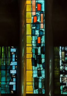 https://flic.kr/p/MkAuj5 | Coventry Cathedral, Baptistery window detail | It consists of 195 individual stained glass panels, and was designed by John Piper and painted by Patrick Reyntiens. Although abstract, some say it represents the spiritual renewal of Baptism and a reminder of the explosive destruction of the old Cathedral. Each panel was pained by Reyntiens.