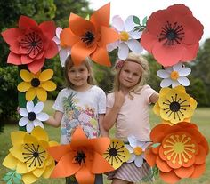 The sweetest girls ever! Fun photo frame made from paper flowers by…