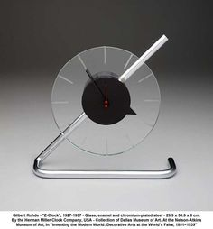 """artwork: Gilbert Rohde - """"Z-Clock"""", 1927-1937 - Glass, enamel and chromium-plated steel - 29.9 x 30.5 x 8 cm. By the Herman Miller Clock Company, USA - Collection of Dallas Museum of Art. At the Nelson-Atkins Museum of Art, in """"Inventing the Modern World: Decorative Arts at the World's Fairs, 1851–1939""""."""