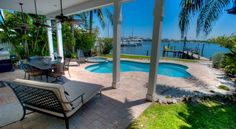 The Bay Front is a luxury island water-front home that has it all. This home has 6 bedrooms and 4 full bathrooms. There are also 2 full gourmet kitchens- one on the first level and one on the second level. There is a new screened-in porch on the second level overlooking the pool which will has full direct views of Anna Maria Sound and the skyline of downtown Sarasota.