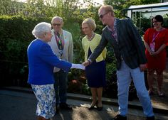 Queen Elizabeth II Photos Photos - Queen Elizabeth II meets Chris Evans and Mary Berry at the BBC Radio 2 Garden at the RHS Chelsea Flower Show press day at Royal Hospital Chelsea on May 22, 2017 in London, England. The prestigious Chelsea Flower Show, held annually since 1913 in the Royal Hospital Chelsea grounds, is open to the public from the 23rd to the 27th of May, 2017. - Members Of The Royal Family Visit The RHS Chelsea Flower Show
