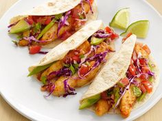 Fill the warm tortillas with the fried fish, avocado, slaw and salsa, and serve with lime wedges.