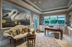 Gray home office with vintage decor and Mediterranean style [Design: Harwick Homes]