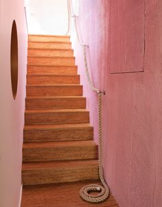 Bright pink walls and cork stairs lead to the children's room. Photo by Lisa Romerein.