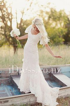 ivory lace flutter sleeve scalloped spring wedding dress