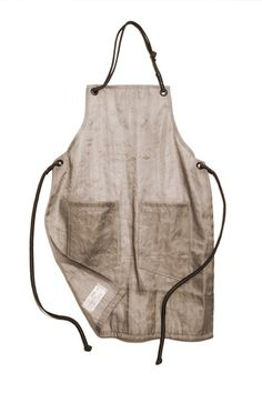 Apron made from repurposed filter cloth and climbing ropes.