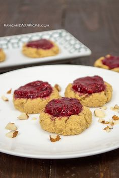 Show your love by making these easy almond raspberry thumbprint cookies. Simple, gluten free, vegan, paleo and only need one bowl, no fancy mixer required! High protein and packed with fiber to keep you full! | www.pancakewarriors.com