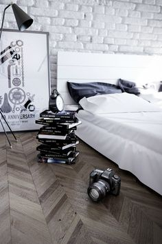 The stack of books and the camera on the floor appeal the most to me! #accessorizing #accessorising