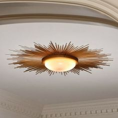If you remember, on my 2014 To Do List was a spruce up of our entry including a diy  ceiling light. This gold sunburst flush mount light wa...