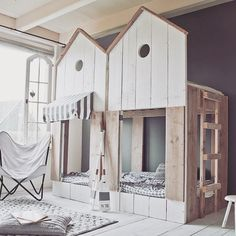 house loft bed play area with side-by-side city facade via bestkiddos
