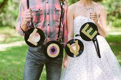 Vinyl record sign ⎪ Ashleigh Jayne Photography ⎪ see more on: http://burnettsboards.com/2014/11/retro-lovin-wedding-ideas/