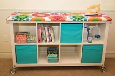 """My version of of a Big Board Iron station. Ikea Expedit Bookcase, installed Expedit Casters, cut plywood 60"""" x 22"""", secured 4 layers batting with staple gun, followed this tutorial for cover http://www.minneapolismqg.com/2013/07/saturday-series-quilting-away-from-home.html"""
