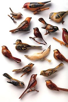 """""""These wooden birds, carved inside world war II-era japanese  american internment camps, are a sampling of the artwork in  """"the art of gaman"""" by delphine hirasuna. the bird's tiny legs  were crafted from the surplus snipped off the wire mesh  screens over barrack windows."""""""