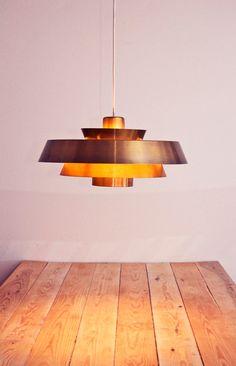 This is an absolutely gorgeous Danish mid-century light Nova by Danish designer Jo Hammerborg. Beautiful gradient lighting! Made of brass. Cream and