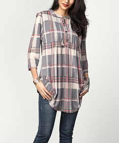Polish your casual looks in this chic tunic flaunting a cheerful plaid print and pin-tuck detailing. Sturdy, brushed polyester fabric lends extra weight and warmth. Shipping note: This item is made to order. Allow extra time for your special find to ship.