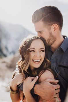 Alayna G Clark photography unique engagement ideas cute couples fun couples candid fun engagement session laughing photos indoor engagement session wedding inspiration not posed engagement photos Utah wedding photographer -
