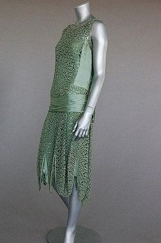Jeanne Paquin labelled green lace and satin dress, summer 1927.  Large woven satin label, dated and numbered 40563, with diagonal satin bands converging at the front with two floating panels, internal satin waist slip, bust 92cm, 36in.  Estimate £ 500 - £ 700.   Kerry Taylor Auctions - London - June 17, 2009.