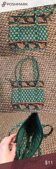 "Green Vera Bradley Hand Bag For sale is a cute dark green patterned Vera Bradley shoulder bag. The front features a small pocket with a smaller Velcro pocket and inside features 6 individual pockets.  The bag is zip closure for easy carrying and features 2 straps. Dimensions are 9.5"" x 11"" Vera Bradley Bags Shoulder Bags"