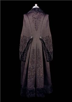 Black wool bat-wing coat with braiding, 1880s
