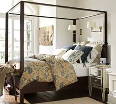 Love the sconces and the mix of wood and the mirror dresser