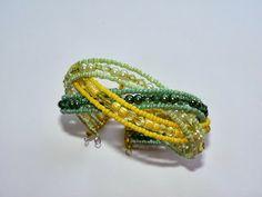 Fonott memória karkötő / zöld-sárga