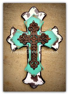 Wall Cross - Wood Cross - Medium - Antiqued Turquoise, Brown & White Cow Print , with large iron cross by happygoose on Etsy https://www.etsy.com/listing/207380156/wall-cross-wood-cross-medium-antiqued