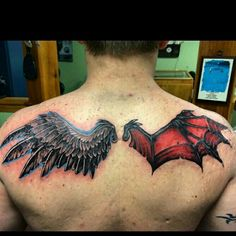 Angel and Demon Wings back tattoo by Wayne Morel