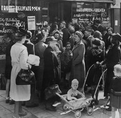 1940. Residents of Amsterdam in line to collect ration distribution coupons at an office in Amsterdam. The Netherlands had already introduced a food distribution system in September 1939. Shortly after the occupation had started the Germans introduced, in June 1940, their own food distribution system. Photo Getty Images. #amsterdam #1940 #worldwar2