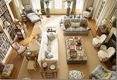 Patterns. furniture arrangement - one primary sitting arrangement around the fire with a desk and library wall behind, secondary seating areas by the windows, occasional chairs around the room