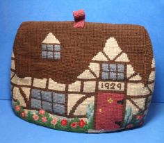 EMBROIDERED WOOL TAPESTRY COUNTRY COTTAGE TEA COSY, dated 1929