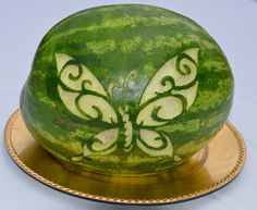 Carved watermelon (it's realy the same as a pumpkin)   How cool would it be to have an eagle???   Or BSA symbol?   Scoop and serve watermelon!