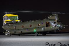 https://flic.kr/p/Nb1e7z   ZA683 / Royal Air Force / Chinook HC4   Known as 'Nellie' due to the aircraft's striking paint scheme. this CH-47 Chinook is operated by 27 Squadron. It is seen here at RAF Northolt during a night photoshoot.  Canon 7D Canon 24-105 L